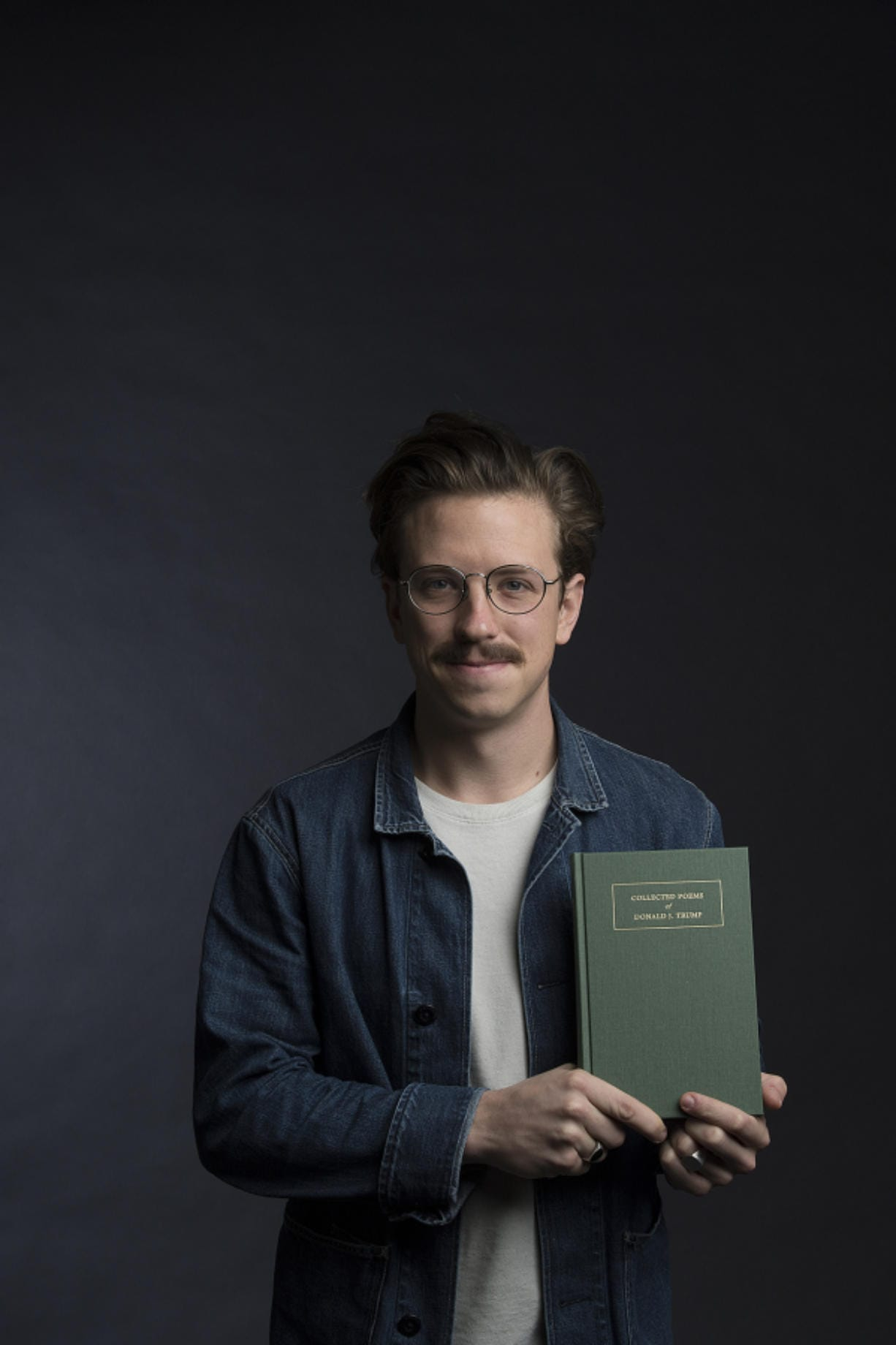 """Poetry or tweetery? Vancouver resident Gregory Woodman, who masterminded this classy, hardbound volume entitled """"Collected Poems of Donald J. Trump,"""" wants you to be the judge. (Amanda Cowan/The Columbian)"""
