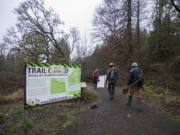 Volunteers with the Washington Trails Association make their way to the north loop of the Oaks to Wetlands trail in the Ridgefield National Wildlife Refuge, where they've been invited to help with a major redesign-and-rebuild project.