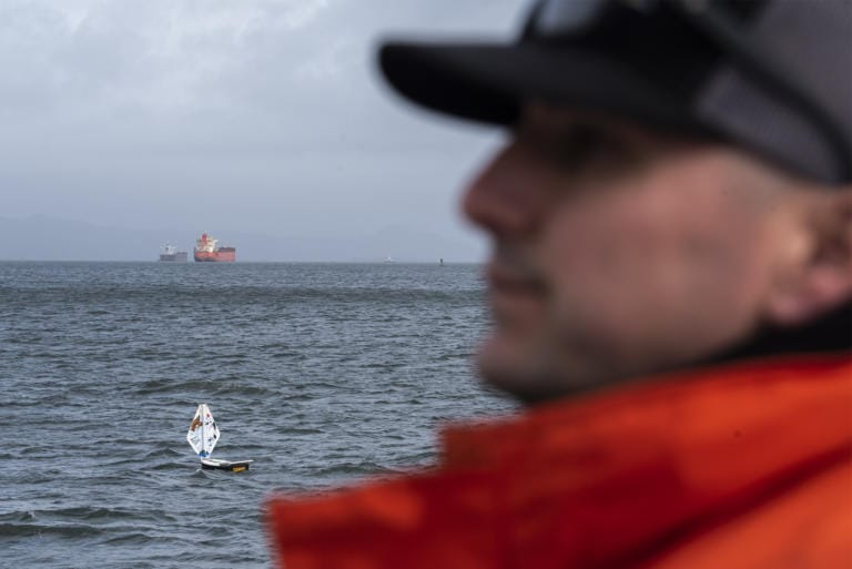 Pilot boat operator Frank Shucks watches as the mini boat S/V The Goonies sails down the Columbia River during a test launch in Astoria, Ore., on Tuesday afternoon, Jan. 21, 2020.