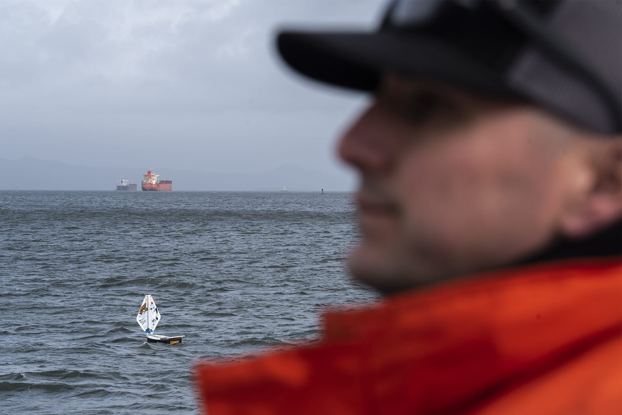 Pilot boat operator Frank Shucks watches as the mini boat S/V The Goonies sails down the Columbia River during a test launch in Astoria, Ore., on Tuesday afternoon, Jan. 21, 2020.  (Nathan Howard/The Columbian)