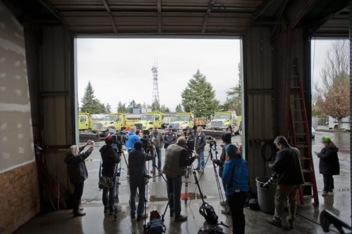 The media turned out in force Friday at Washington State Department of Transportation's maintenance yard in west Vancouver to hear how the biggest transportation agencies are prepared for potential snowy weather next week. (James Rexroad for The Columbian)