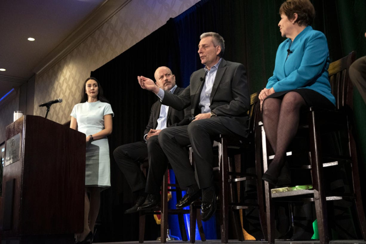 Nathan Howard/The Columbian A panel discussion was part of this year's economic forecast breakfast, along with a keynote speaker and a regional economist.