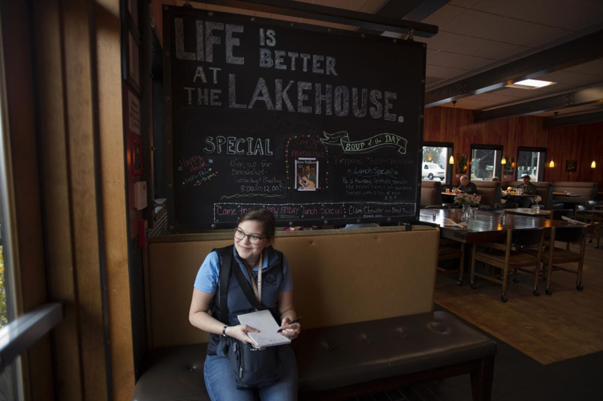 Maggie Yaddof makes a few notes before starting her inspection at the Fargher Lakehouse. (Amanda Cowan/The Columbian)