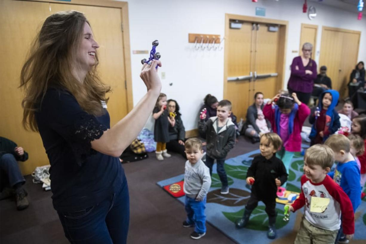 Elizabeth Moss, 37, senior public services librarian at Three Creeks Community Library, leads a preschool storytime in dance. Moss started her journey into librarian work about 10 years ago after working as a theater teacher at a Las Vegas high school.