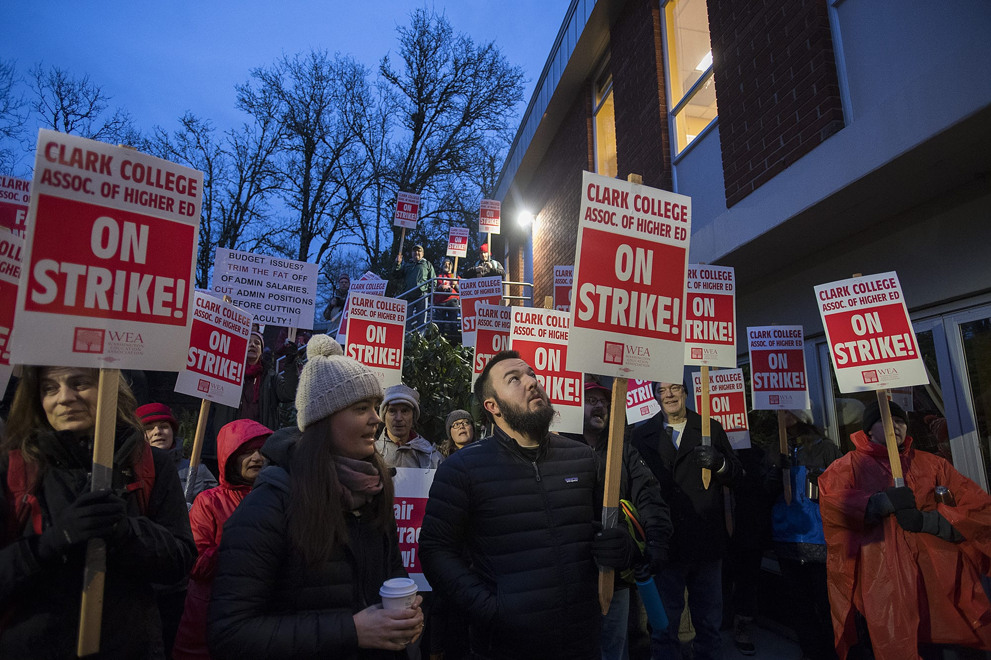 Dozens of Clark College faculty members gather at Baird Hall to chant outside the Board of Trustees meeting while on strike Monday morning, Jan. 13, 2020. (Amanda Cowan/The Columbian)