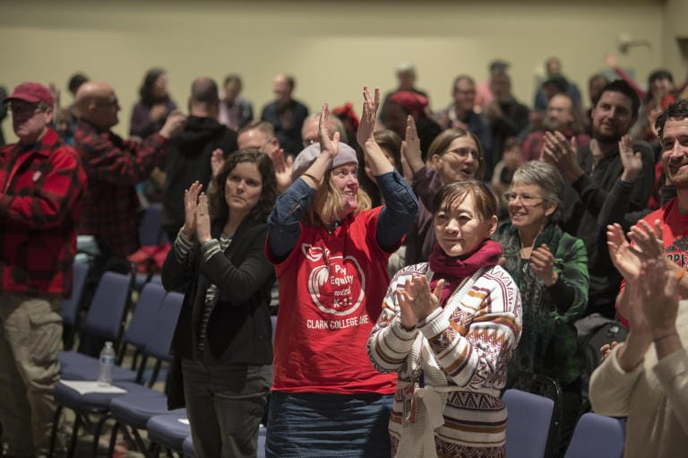 Members of the Clark College Association for Higher Education react with a standing ovation after the union vote was announced at Gaiser Hall on Wednesday afternoon, Jan. 15, 2020. The contract was ratified 257-9. (Amanda Cowan/The Columbian)