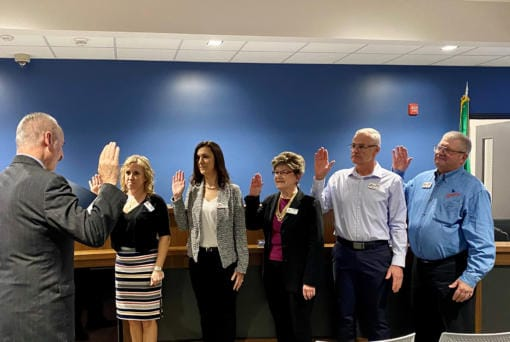 Clark County District Court Judge Darvin Zimmerman, left, swears in members of the new Ridgefield City Council at the Jan. 9 meeting: Dana Ziemer, from left, Jennifer Lindsay, Sandra Day, Rob Aichele and Lee Wells. (City of Ridgefield)