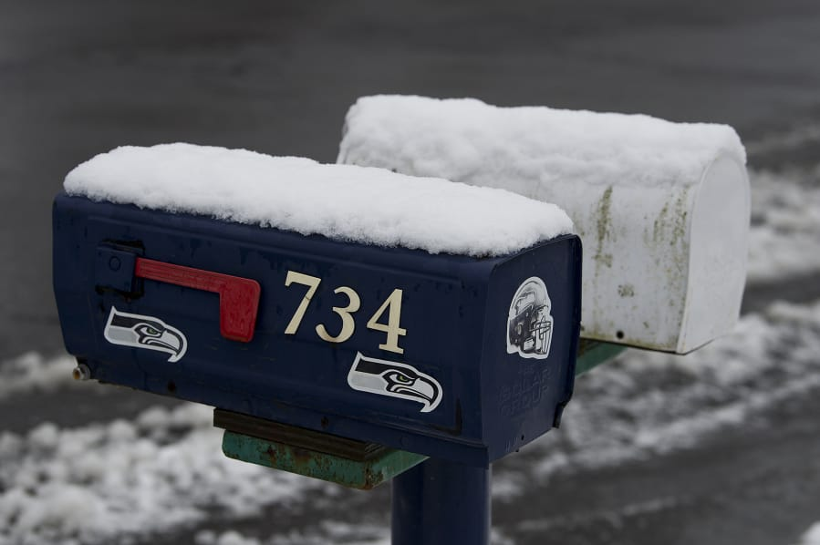 A fresh layer of snow is seen on mailboxes in the Prune Hill area of Camas on Thursday morning. (Amanda Cowan/The Columbian)