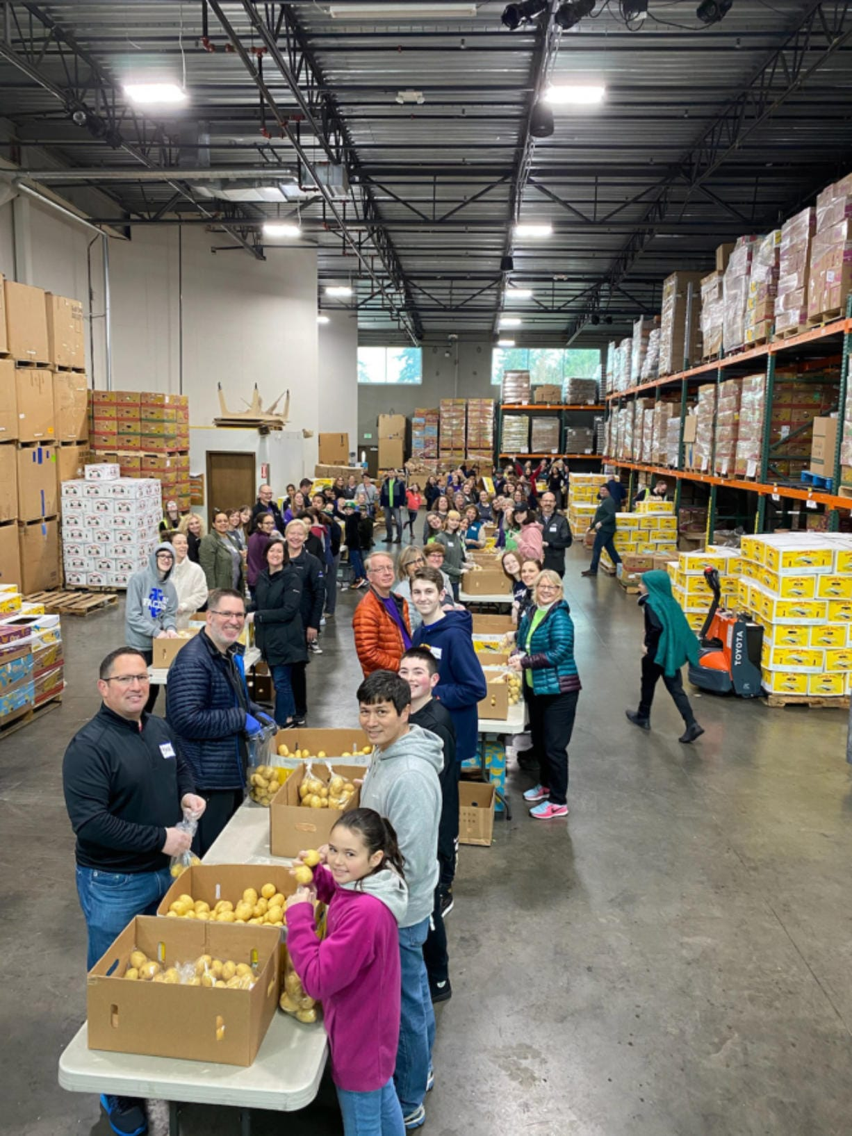 MINNEHAHA: More than 100 Kaiser Permanente employees from Southwest Washington and Oregon volunteered with their families and friends to sort 40,000 pounds of potatoes at the Clark County Food Bank on Martin Luther King Jr.