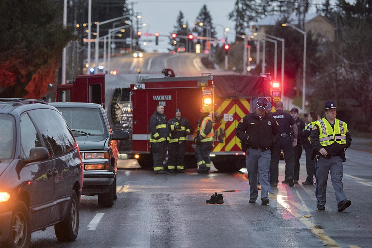 Police investigate the scene after two pedestrians were struck and killed in east Vancouver on Tuesday morning, Jan. 21, 2020. (Amanda Cowan/The Columbian)