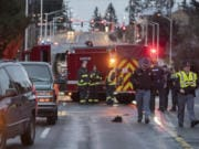 Police investigate the scene after two pedestrians were struck and killed in east Vancouver on Tuesday morning, Jan. 21, 2020.