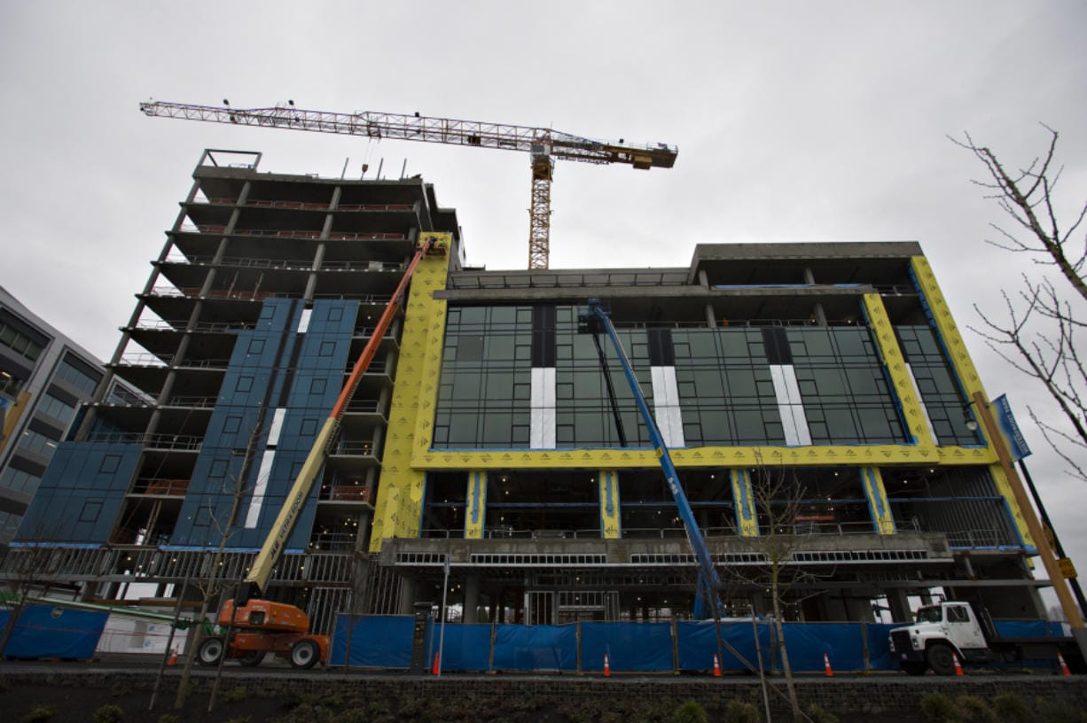 Construction of the exterior cladding of the Hotel Indigo and Kirkland Tower building is underway. The building structure is supported by its own internal skeleton, allowing for extensive use of glass in the outer walls. (Amanda Cowan/The Columbian)