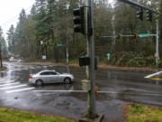 Traffic drives Jan. 23 through the intersection of Northeast Everett Street and Northeast Lake Road in Camas at the site of a proposed roundabout.