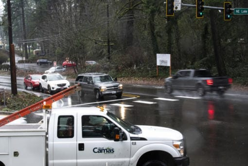Cars pass through the intersection of Northeast Everett Street and Northeast Lake Road in Camas on Thursday at the site of a roundabout.