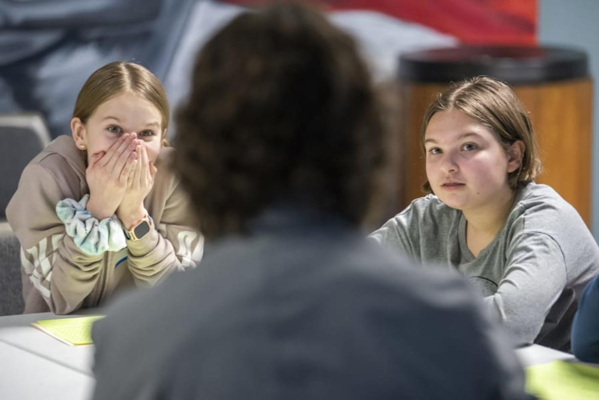 Madelyn Grimes, 11, left, and Melorah Crichton, 11, listen to Jeff Causey, a sixth-grade counselor at Discovery Middle School, during a social and emotional learning session on Monday.