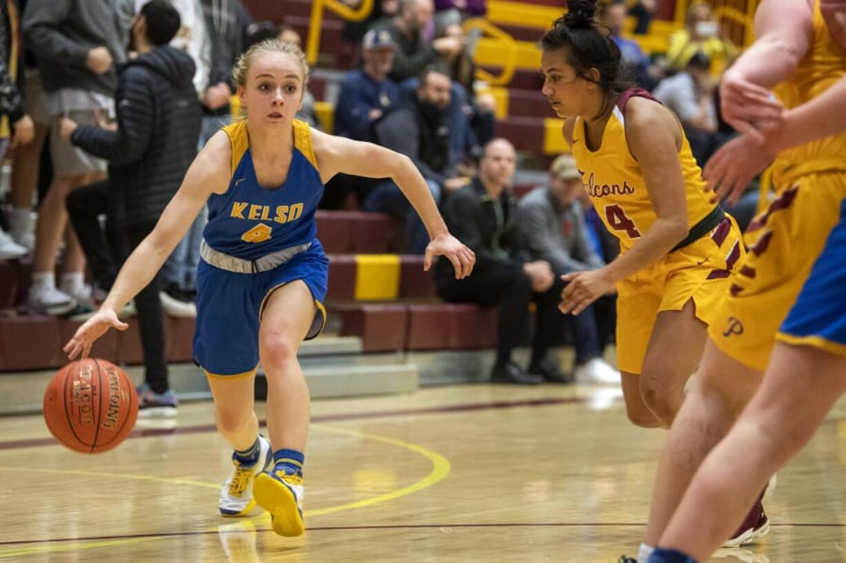 Kelso's Alexis Kleven (4) dribbles down court during Tuesday night's game at Prairie High School in Vancouver on Jan. 28, 2020.
