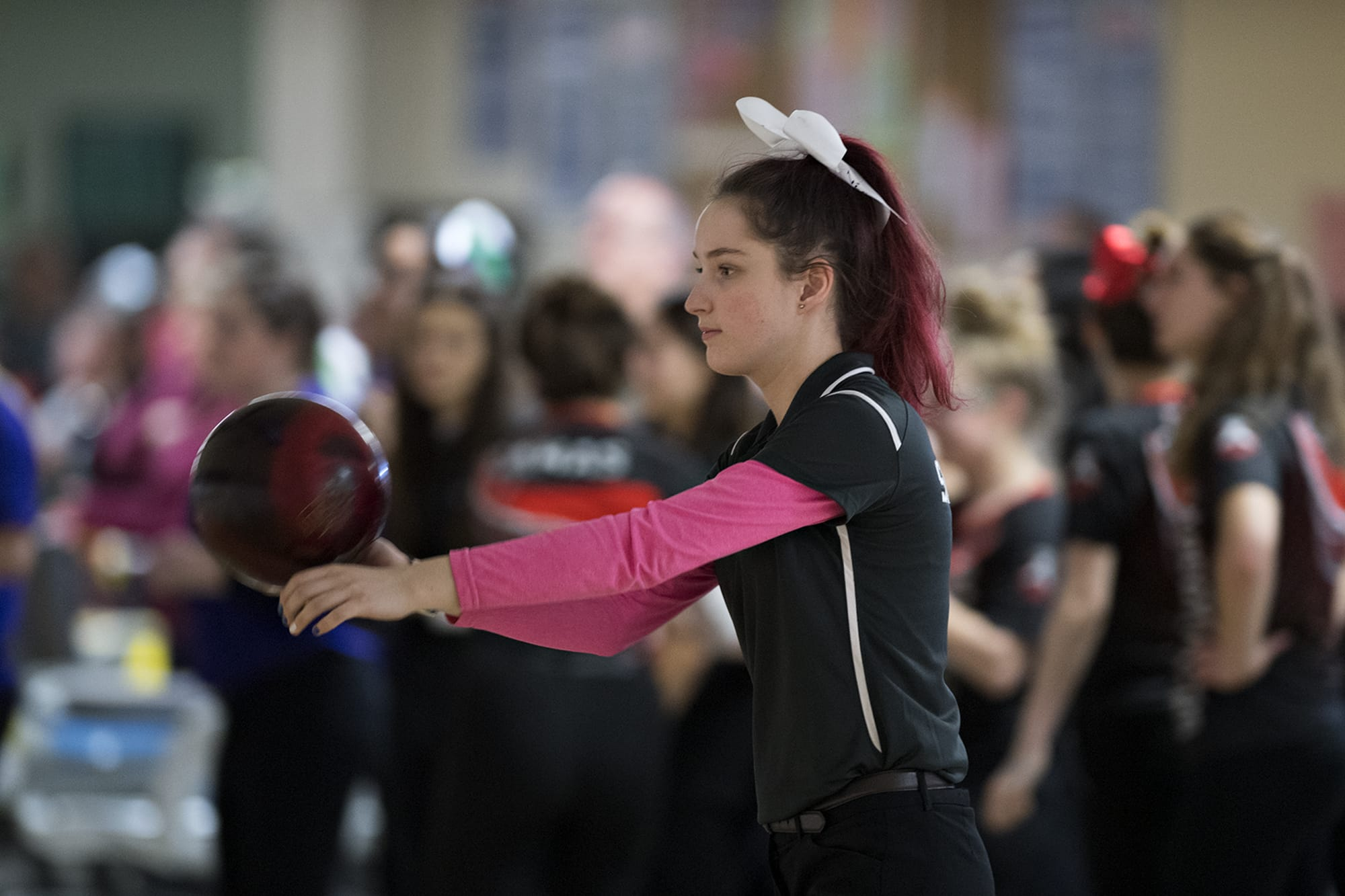 Skyview's Nicole Hayes steps up to the approach during girls district bowling action at Crosley Lanes on Friday afternoon, Jan. 31, 2020. (Amanda Cowan/The Columbian)