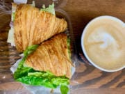 A turkey and swiss sandwich and a latte at The Birds and The Beans Coffee Shop in Ridgefield.