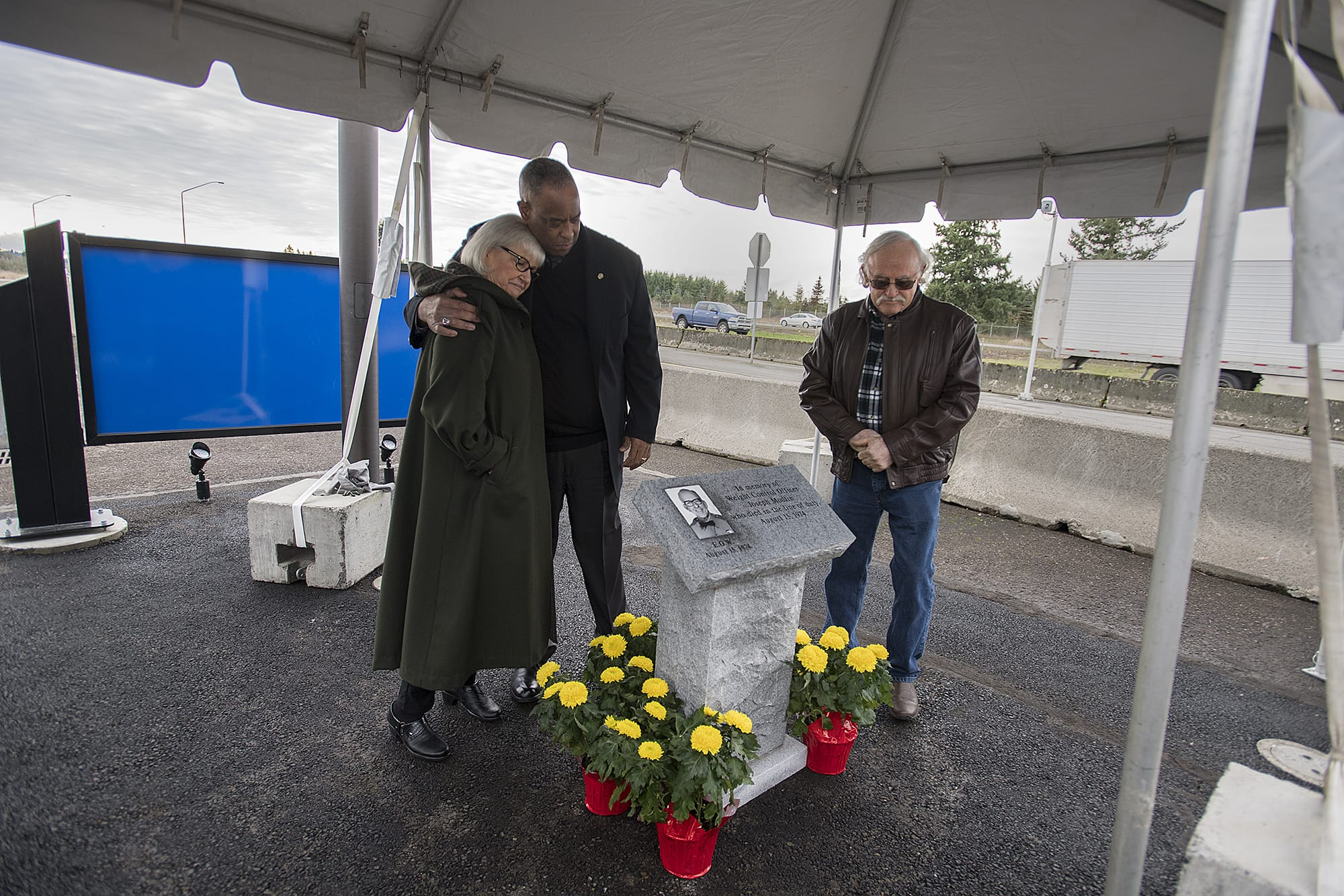 Louanne Mason, daughter of Weight Control Officer Joseph Modlin, from left, and John Batiste, Chief of Washington State Patrol, join Mason's husband, Doug, after unveiling a memorial plaque in honor of Modlin at the Ridgefield Port of Entry on Thursday morning, Jan. 30, 2020. Officer Modlin died in the line of duty on August 15, 1974 when he was struck by a logging truck. The Washington State Patrol Motor Carrier Safety Division also hosted a grand opening and dedication of the newly built Ridgefield Port of Entry during the event. (Amanda Cowan/The Columbian)