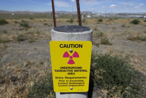 """In this photo taken July 11, 2016, a sign warns of radioactive material stored underground on the Hanford Nuclear Reservation near Richland, Wash. The U.S. Energy Department""""EYs top official at Washington state""""EYs severely contaminated  nuclear reservation says future accidental nuclear radiation releases are likely because of aging site infrastructure and inadequate cleanup funding.  Hundreds were evacuated May 9, 2017 when the roof of a 1950s rail tunnel storing a lethal mix of waste from plutonium production collapsed. Tests show no radiation was released. (AP Photo/Ted S."""