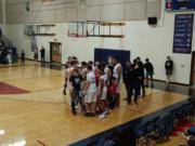 King's Way Christian boys basketball team celebrates its 56-50 win over La Center on Tuesday, Jan.