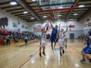 La Center's Hunter Ecklund drives to the basket during the Wildcats' win Thursday against Columbia-White Salmon.