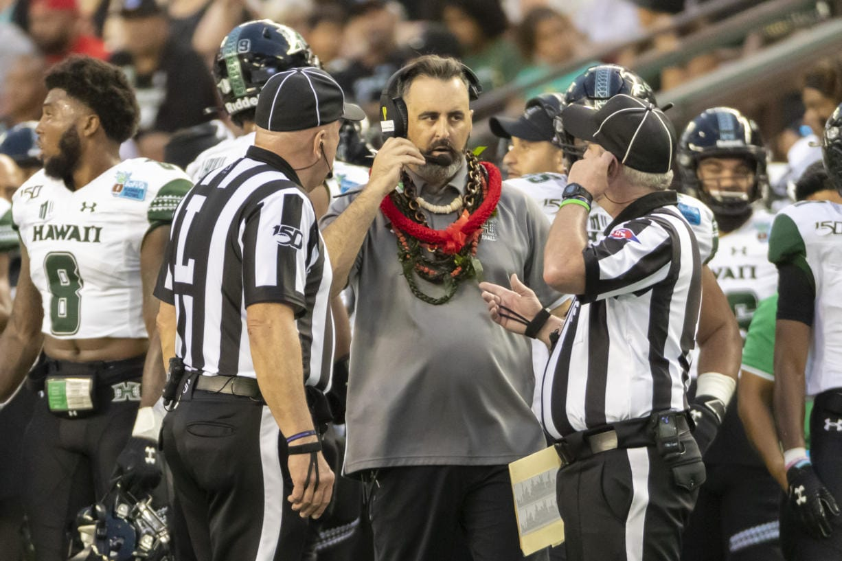 Hawaii head coach Nick Rolovich, center, speaks with the game officials in the second half of the Hawaii Bowl NCAA college football game, Tuesday, Dec. 24, 2019, in Honolulu.