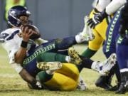 Green Bay Packers' Preston Smith sacks Seattle Seahawks' Russell Wilson during the second half of an NFL divisional playoff football game Sunday, Jan. 12, 2020, in Green Bay, Wis.