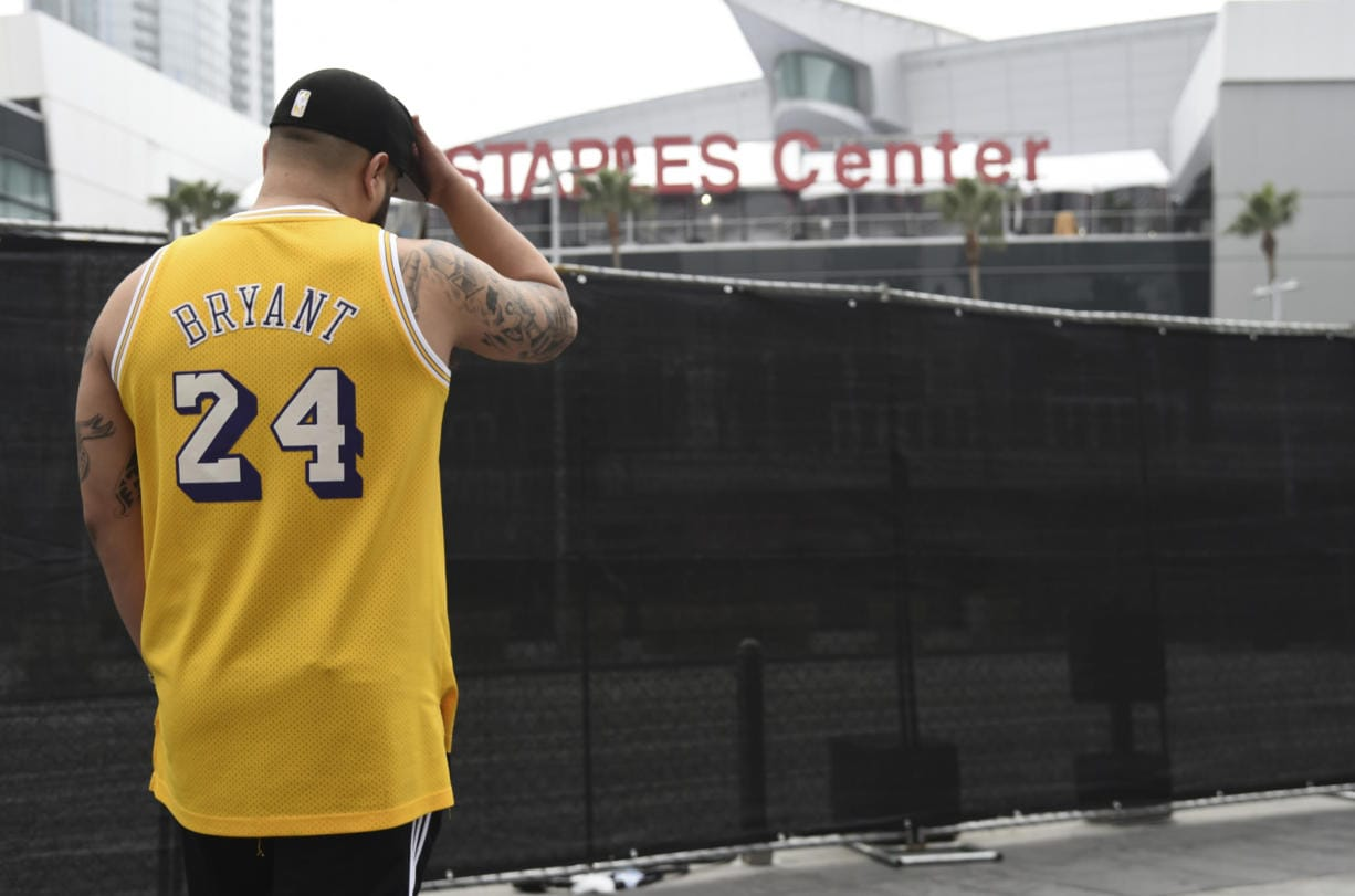 Gennesys Cabral, of Los Angeles, wears a Kobe Bryant jersey outside of the Staples Center at the 62nd annual Grammy Awards on Sunday, Jan. 26, 2020, in Los Angeles. Bryant died Sunday in a helicopter crash near Calabasas, Calif. He was 41.