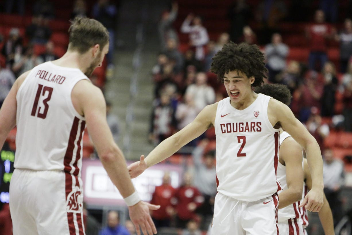 Washington State forward CJ Elleby (2) celebrates his go-ahead basket with forward Jeff Pollard (13) during the second half of the team's NCAA college basketball game against Arizona State in Pullman, Wash., Wednesday, Jan. 29, 2020.