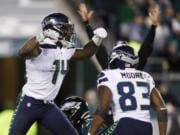 Seattle Seahawks' D.K. Metcalf, left, and David Moore celebrate after Metcalf's touchdown catch during the second half of an NFL wild-card playoff football game against the Philadelphia Eagles, Sunday, Jan. 5, 2020, in Philadelphia.