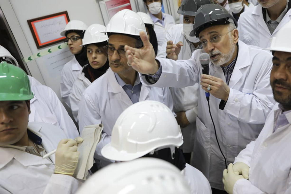 "FILE - In this file photo released Nov. 4, 2019 by the Atomic Energy Organization of Iran, Ali Akbar Salehi, head of the organization, speaks with media while visiting Natanz enrichment facility, in central Iran. The landmark 2015 deal between Tehran and world powers meant to prevent Iran from obtaining nuclear weapons has been teetering on the edge of collapse since the U.S. pulled unilaterally in 2018. The EU said Wednesday, Jan. 8, 2020, that it will ""spare no effort"" to keep the deal alive, but with tensions between the U.S. escalating into open hostilities it's seeming increasingly unlikely that will be possible.  (Atomic Energy Organization of Iran via AP, File)"