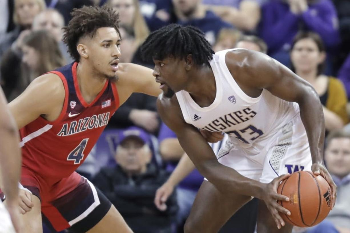 Arizona center Chase Jeter (4) pressures Washington forward Isaiah Stewart (33) during the first half of an NCAA college basketball game Thursday, Jan. 30, 2020, in Seattle. (AP Photo/Ted S.