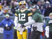 Green Bay Packers head coach Matt LaFleur talks to Aaron Rodgers during the first half of an NFL football game against the Chicago Bears Sunday, Dec. 15, 2019, in Green Bay, Wis.