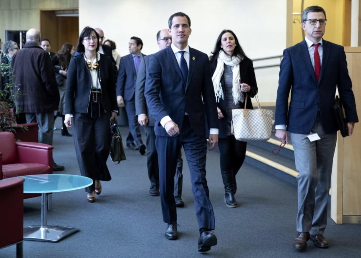 Leader of Venezuela's political opposition Juan Guaido, center, arrives prior to a meeting with European Union foreign policy chief Josep Borrell at EU headquarters on Wednesday, Jan. 22, 2020. (Aris Oikonomou, Pool Photo via AP)
