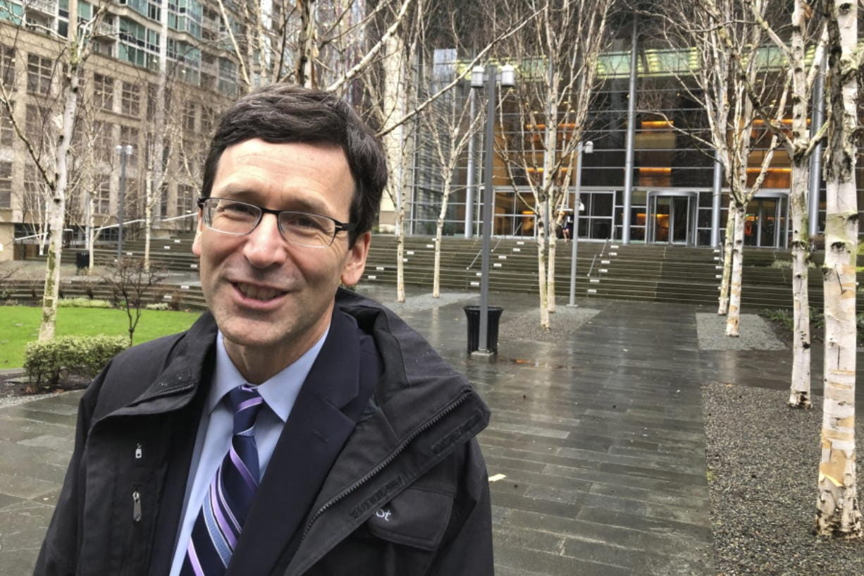 Washington Attorney General Bob Ferguson leaves the U.S. District Court in Seattle Thursday, Jan. 23, 2020, following arguments in his lawsuit challenging the Trump administration's funding of the wall on the U.S.-Mexico border. The administration is diverting $3.6 billion in military construction money, including $89 million for a naval pier in Washington, toward the wall.