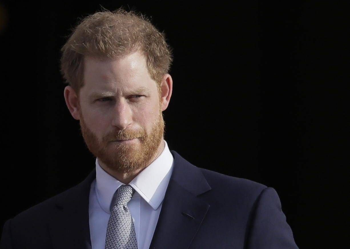 """FILE - In this Thursday, Jan. 16, 2020, file photo, Britain's Prince Harry arrives in the gardens of Buckingham Palace in London. Prince Harry said Sunday, Jan. 19 that he felt """"great sadness"""" but found """"no other option"""" to cutting almost all of his and his wife Meghan's royal ties in the hopes of achieving a more peaceful life. (AP Photo/Kirsty Wigglesworth, File)"""