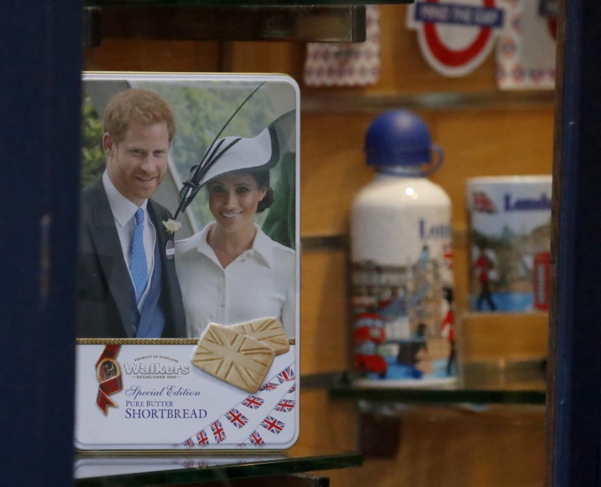 "Merchandising products are seen in a shop window in Windsor, England, Thursday, Jan. 9, 2020.  In a statement Prince Harry and his wife, Meghan, said they are planning ""to step back"" as senior members of the royal family and ""work to become financially independent.""(AP Photo/Frank Augstein)"