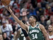 Milwaukee Bucks forward Giannis Antetokounmpo (34) shoots over Portland Trail Blazers forward Anthony Tolliver during the second half of an NBA basketball game in Portland, Ore., Saturday, Jan. 11, 2020.