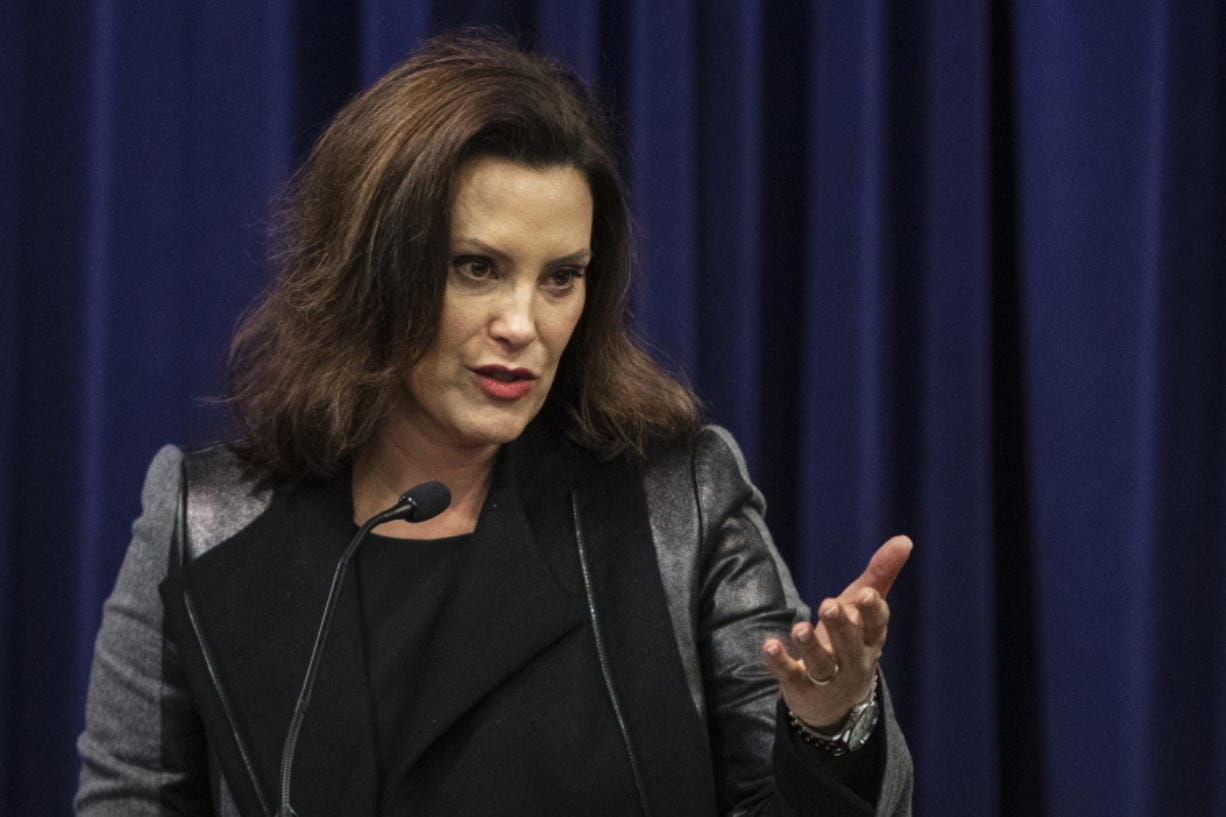 """Governor Gretchen Whitmer speaks after Michigan Attorney General Dana Nessel announced a lawsuit against 17 PFAS manufacturers at the Attorney General's office in Lansing, Mich., on Tuesday, Jan. 14, 2020. Michigan sued 3M, DuPont and other companies for financial damages from contamination caused by potentially harmful """"forever"""" chemicals that are turning up in drinking water across a state known for industrial manufacturing. (Joel Bissell/MLive.com/Kalamazoo Gazette via AP)"""