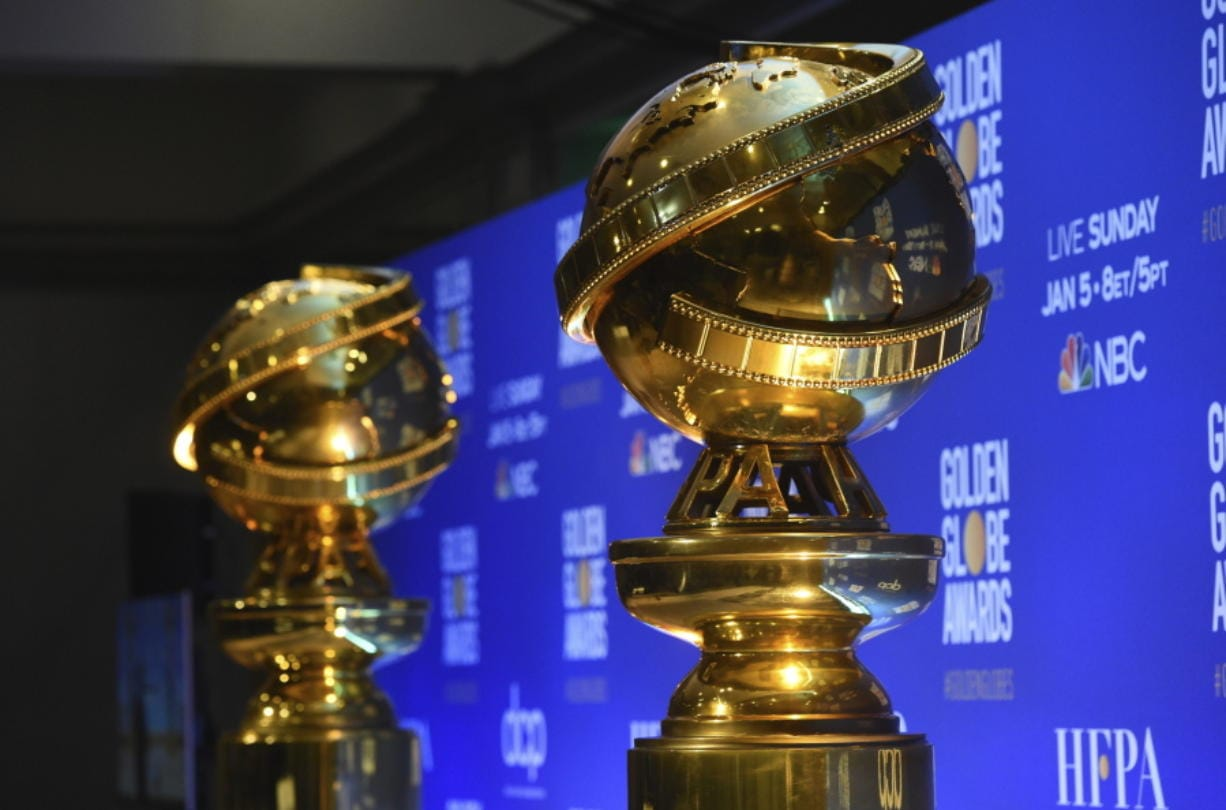 FILE - This Dec. 9, 2019 file photo shows replicas of Golden Globe statues at the nominations for the 77th annual Golden Globe Awards  in Beverly Hills, Calif. The 77th annual Golden Globe Awards will be held on Sunday, Jan. 5.