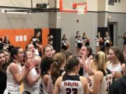 The Washougal girls basketball team breaks a huddle during its 45-40 win over Columbia River on Friday at Washougal High (Micah Rice/The Columbian)