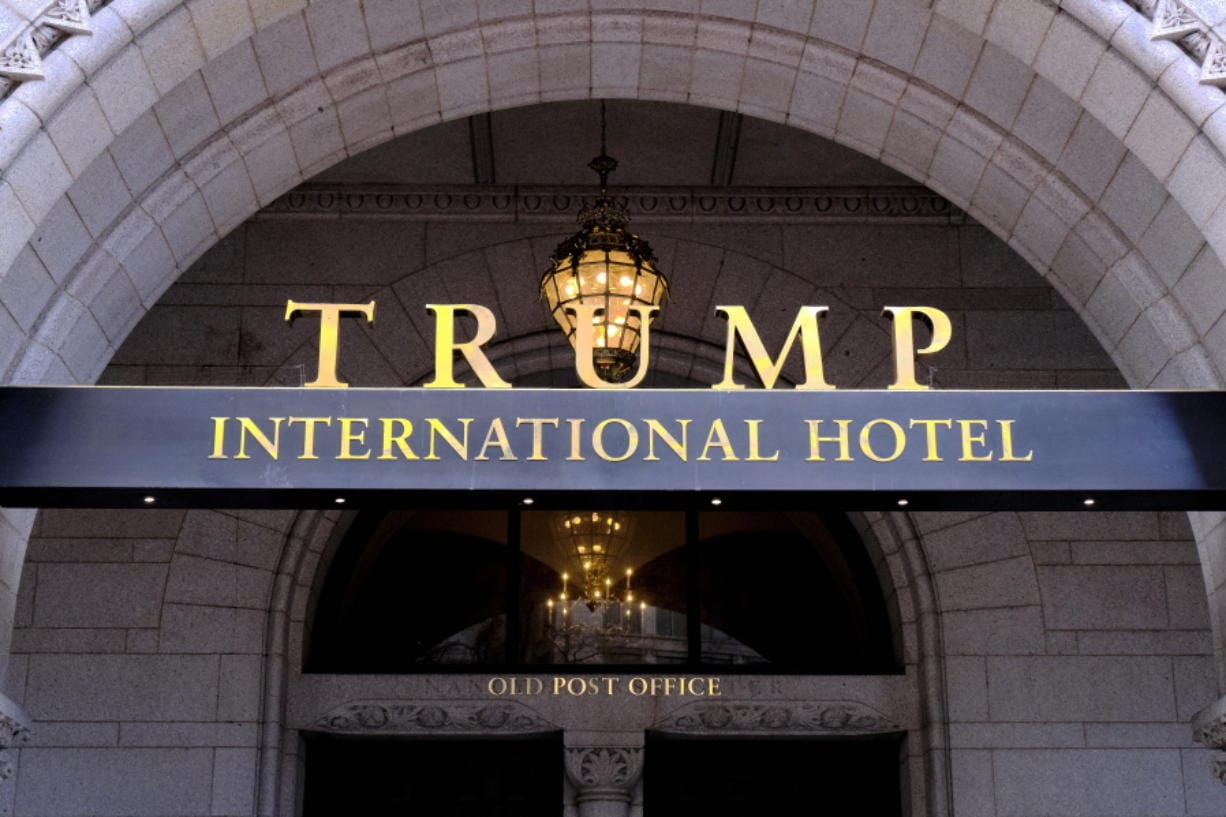 FILE - In this March 11, 2019 file photo, the Trump International Hotel is seen in Washington. District of Columbia Attorney General is suing President Donald Trump's inaugural committee and two companies that control the Trump International Hotel in D.C., accusing the groups of abusing nonprofit funds to benefit Trump's family.
