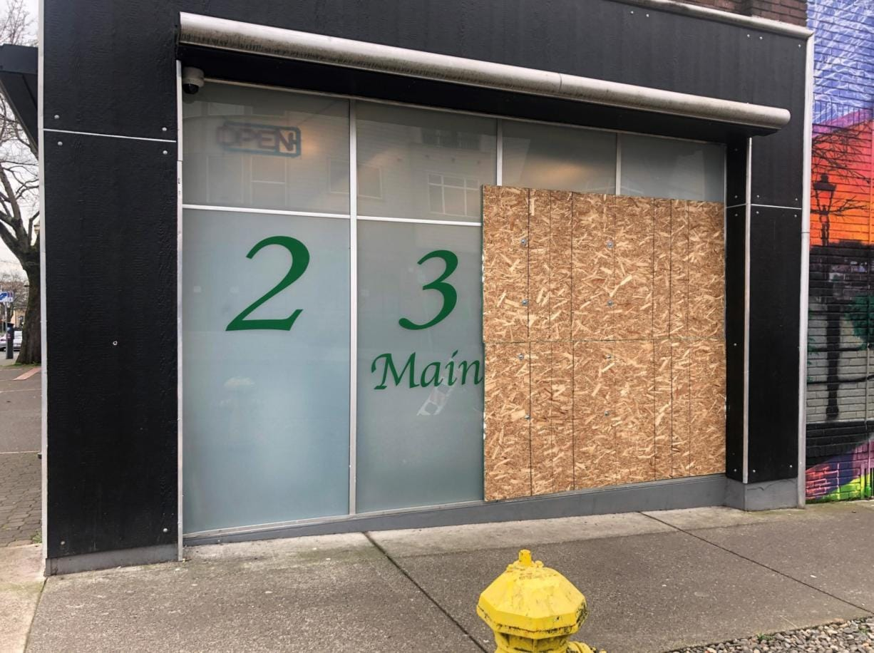 Vancouver police officers responded around 6:20 a.m. Saturday to Main Street Marijuana at 2314 Main Street for the report of a commercial burglary that just happened. Two large windows on the side of Main Street Marijuana facing West 24th Street were boarded up Monday morning. (Will Campbell/The Columbian)
