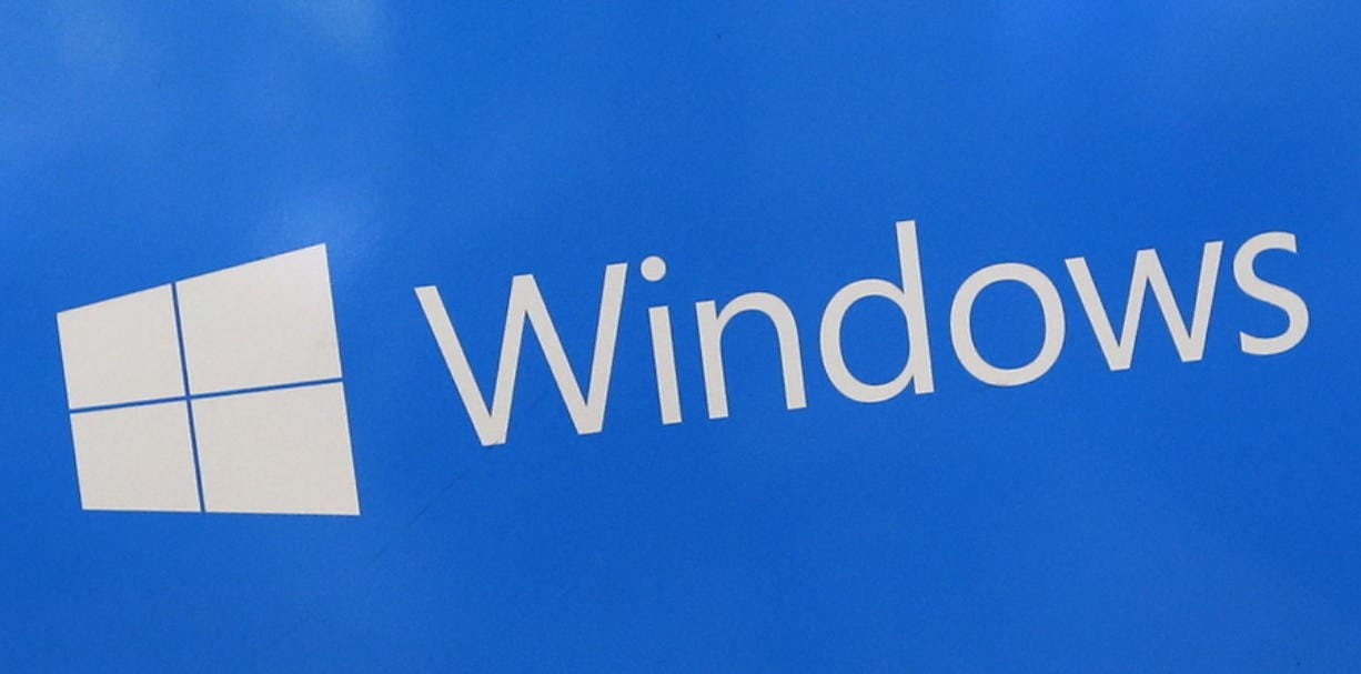 FILE - This Aug. 7, 2017, file shows a Microsoft Widows sign on display at a store in Hialeah, Fla. The National Security Agency has discovered a major security flaw in Microsoft's Windows operating system. Microsoft says the NSA notified the company about it. A fix was made available Tuesday, Jan. 14, 2020.