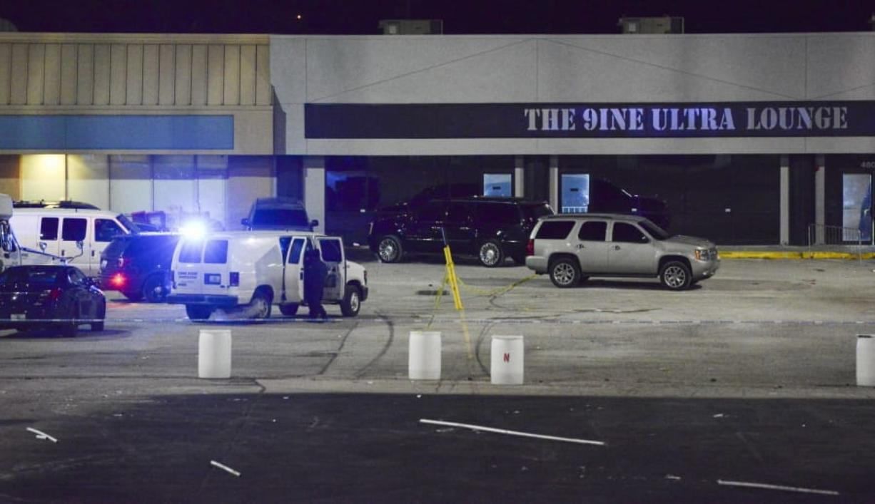 Kansas City, Mo., police crime scene investigators gather evidence at the scene of a shooting at a nightclub in the early hours of Monday, Jan. 20, 2020, in Kansas City, Mo. Police say an armed security guard may have shot and killed a man suspected of fatally shooting a woman and injuring 15 more people outside a bar in Kansas City(Luke Nozicka/The Kansas City Star via AP)
