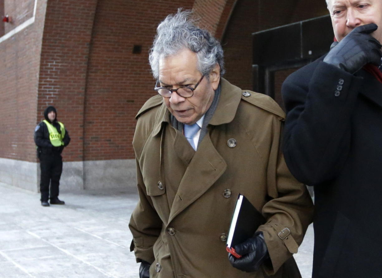 FILE - In this Jan. 30, 2019, file photo, Insys Therapeutics founder John Kapoor leaves federal court in Boston. Kapoor is scheduled to be sentenced in Boston's federal court Thursday, Jan. 23, 2020, after he was convicted in a bribery and kickback scheme that prosecutors said helped fuel the opioid crisis. (AP Photo/Steven Senne, File)