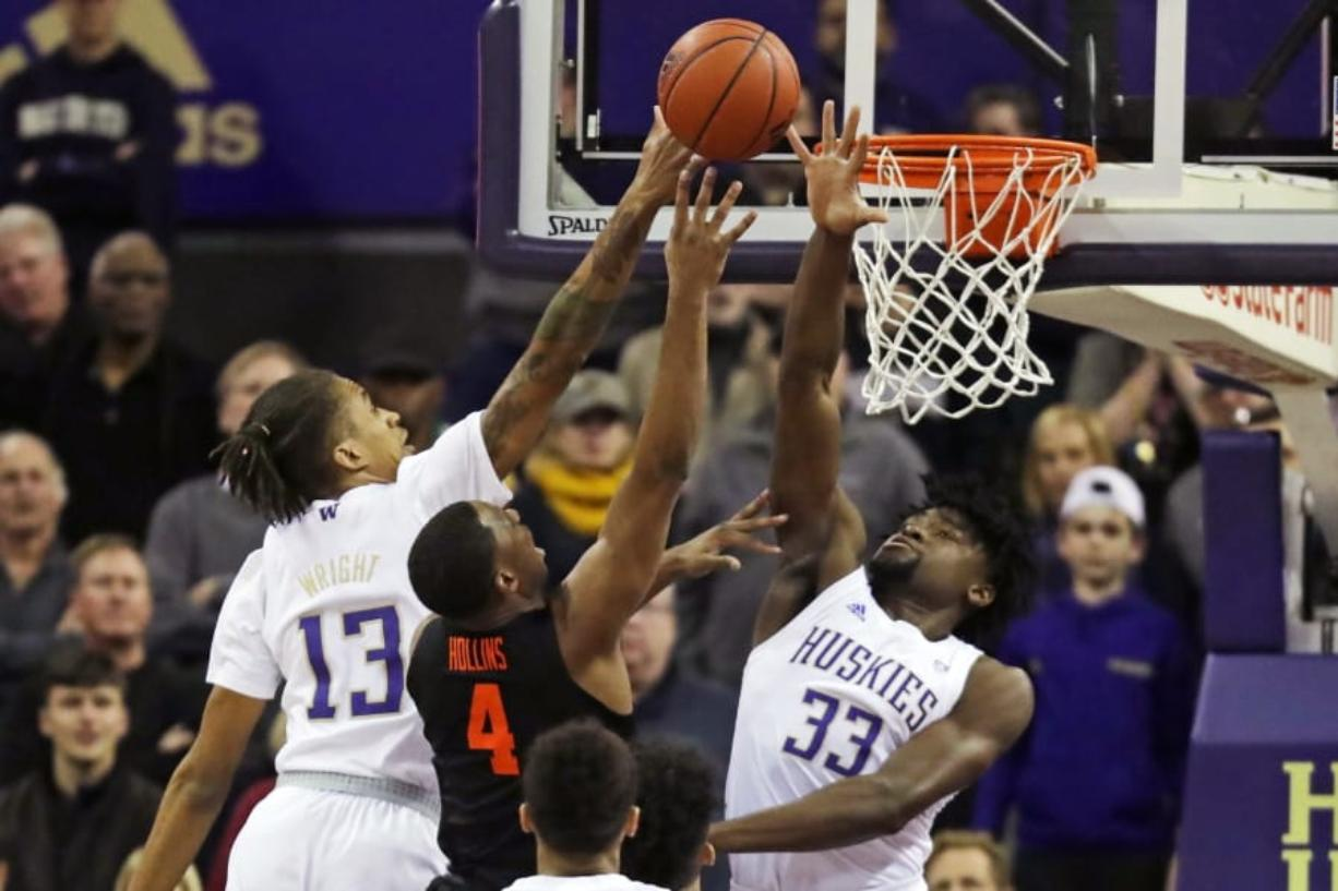 Oregon State forward Alfred Hollins (4) has a shot blocked by Washington forward Isaiah Stewart (33) and forward Hameir Wright (13) during the first half of an NCAA college basketball game Thursday, Jan. 16, 2020, in Seattle. (AP Photo/Ted S.