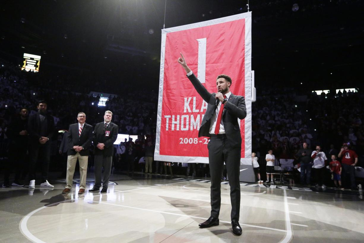 Golden State Warriors and former Washington State guard Klay Thompson speaks as the school retired his jersey number during halftime of an NCAA college basketball game between Washington State and Oregon State in Pullman, Wash., Saturday, Jan. 18, 2020.