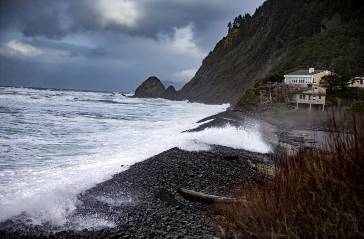 Waves crash along the shore of Falcon Cove Beach Sunday between the unincorporated community of Arch Cape to the north and Oswald West State Park to the south in Clatsop County, Ore.